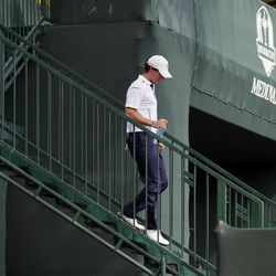 Europe's Rory McIlroy makes his way to the first tee before a singles match at the Ryder Cup PGA golf tournament Sunday, Sept. 30, 2012, at the Medinah Country Club in Medinah, Ill.