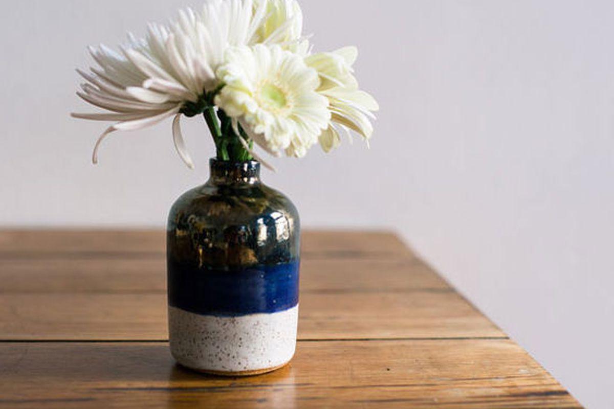 "<a href=""http://www.ofakind.com/editions/1267-INDIGO-CHROME-BOTTLE-VASE#.UV2M4KvuXjA"">Object + Totem Indigo Crome Bottle Vase</a>, $36 at Of a Kind"