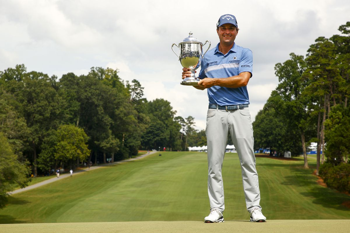 Kevin Kisner of the United States celebrates with the trophy after winning a 6-way sudden-death playoff during the final round of the Wyndham Championship at Sedgefield Country Club on August 15, 2021 in Greensboro, North Carolina.