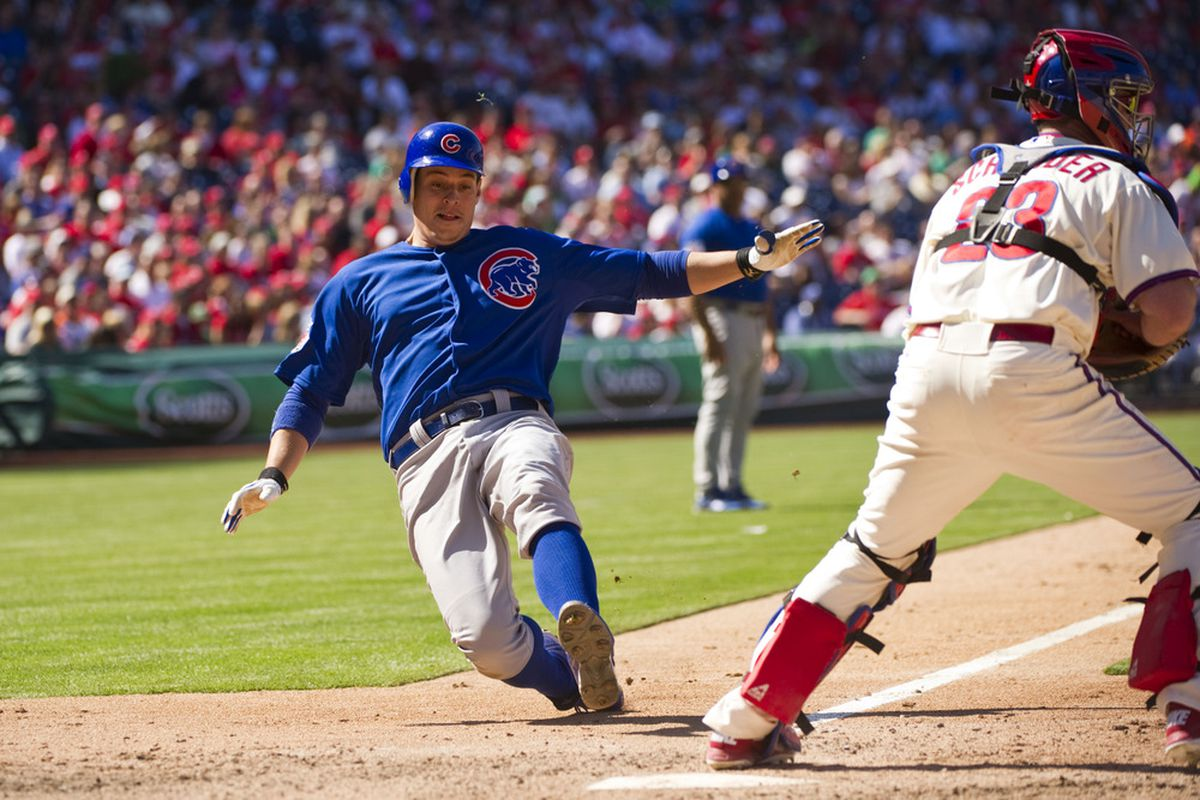 Philadelphia, PA, USA; Chicago Cubs first baseman Bryan LaHair scores beating the throw to Philadelphia Phillies catcher Brian Schneider at Citizens Bank Park. The Cubs defeated the Phillies 5-1. Credit: Howard Smith-US PRESSWIRE