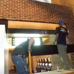 Construction workers get the bar ready at Public House at the Luxor.