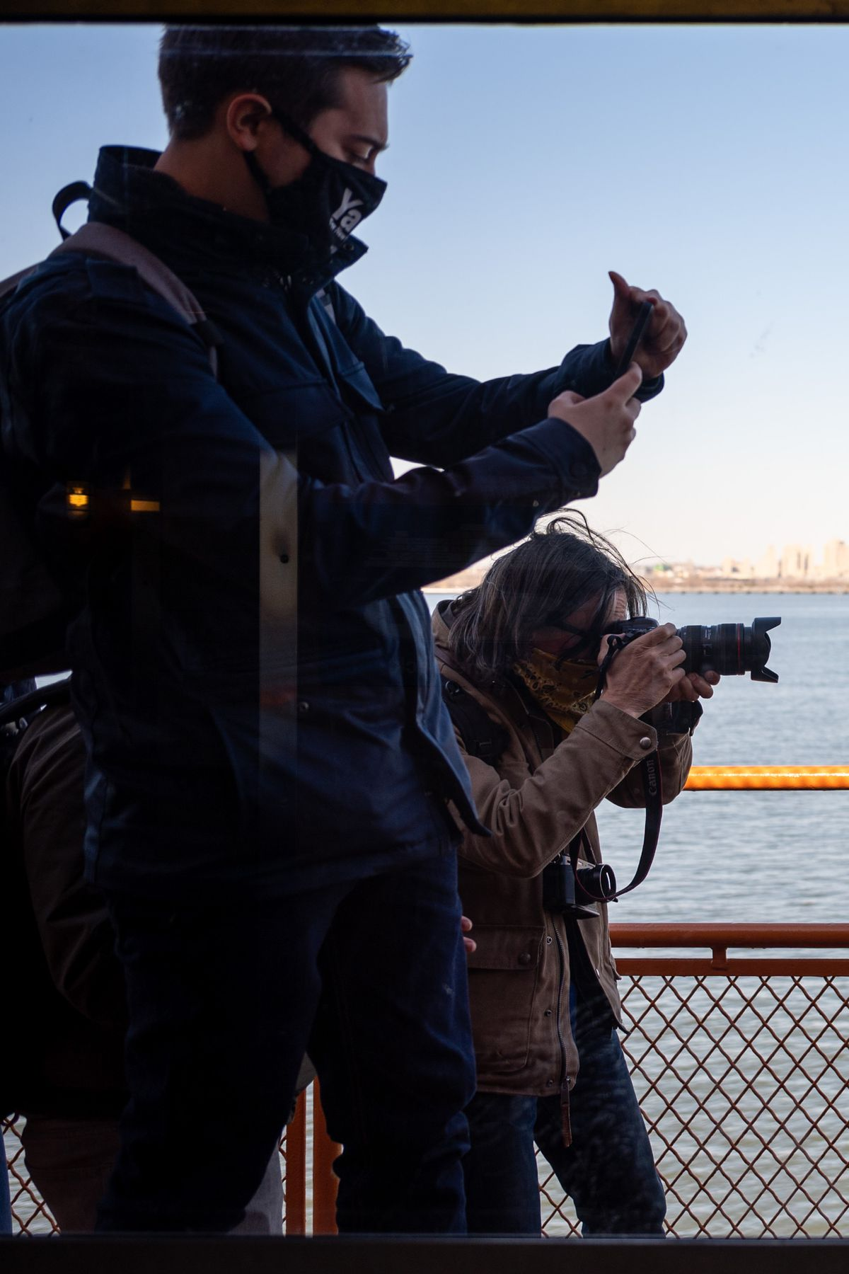 Photojournalist Spencer Platt, right, was photographing mayoral candidate Andrew Yang on the Staten Island Ferry before a passenger unprovoked attacked him with a pole.