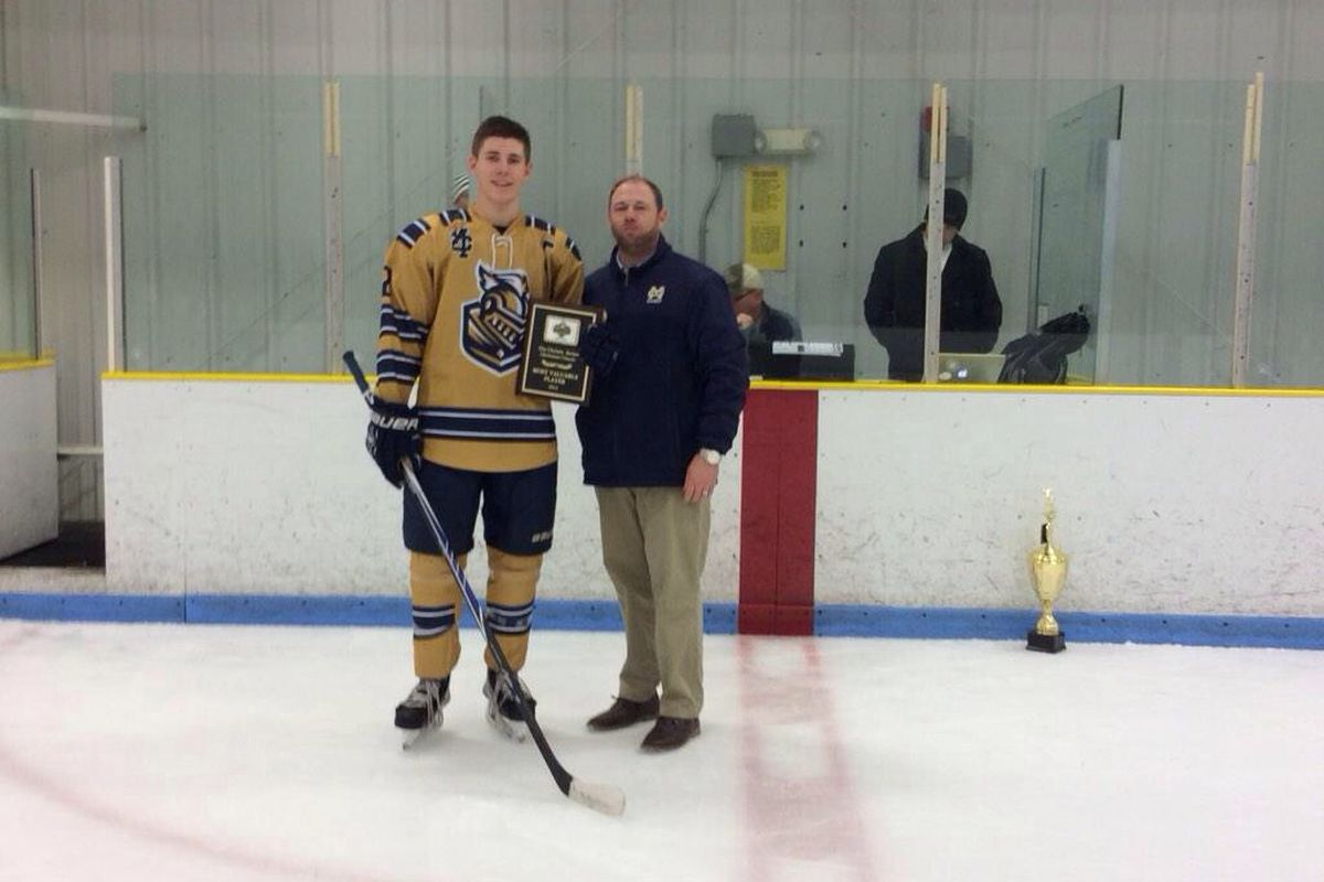 Matt Filipe accepts the Serino Classic MVP Trophy from Malden Catholic Athletic Director and assistant coach Pat Driscoll.