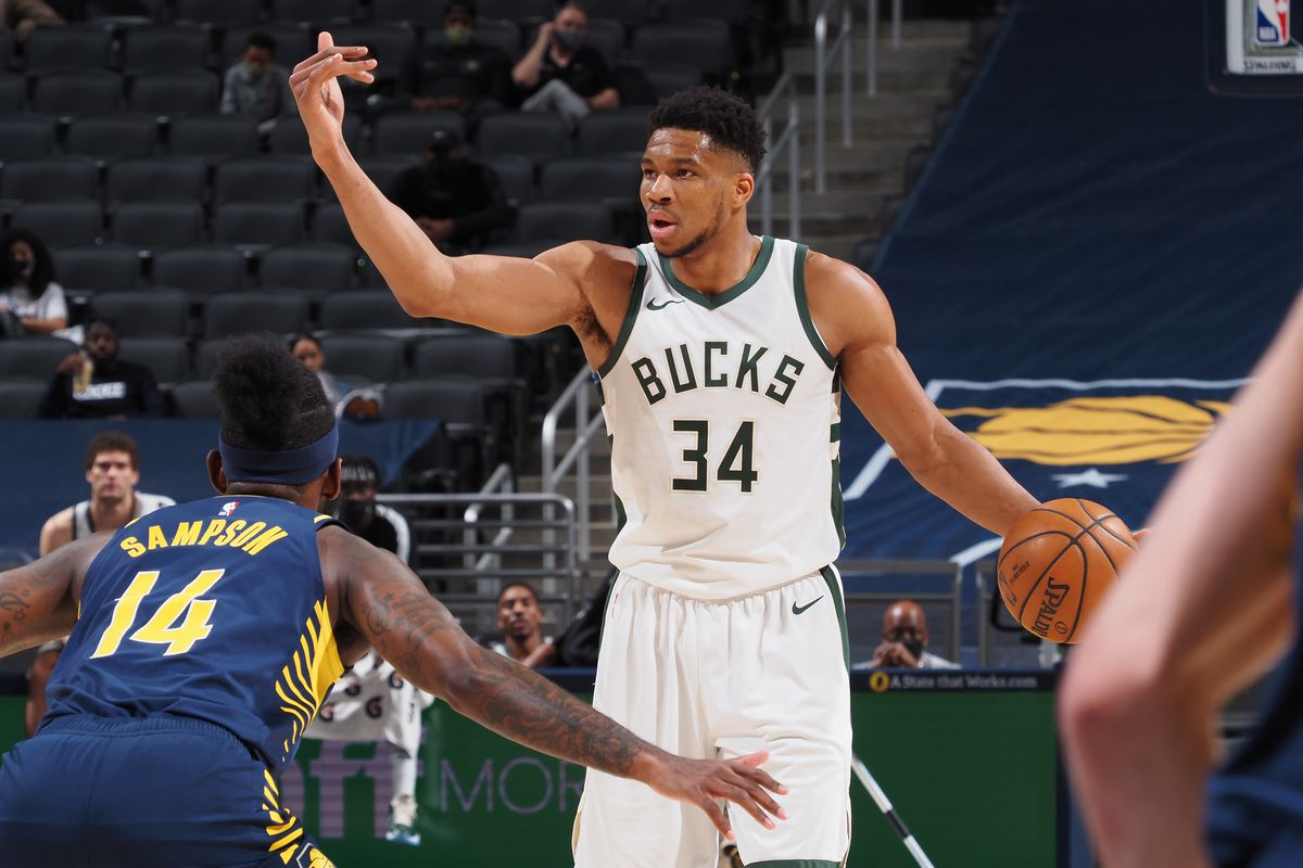 Giannis Antetokounmpo #34 of the Milwaukee Bucks dribbles the ball during the game against the Indiana Pacers on May 13, 2021 at Bankers Life Fieldhouse in Indianapolis, Indiana.