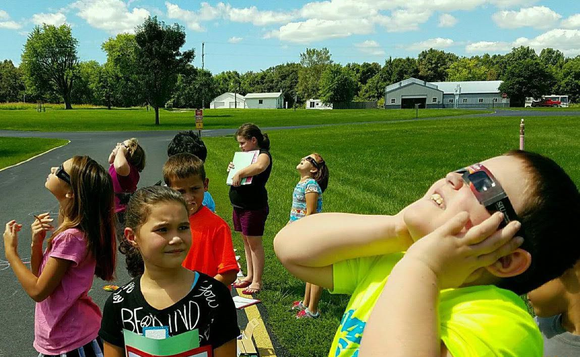 Students at Trico Elementary try out their eclipse glasses.