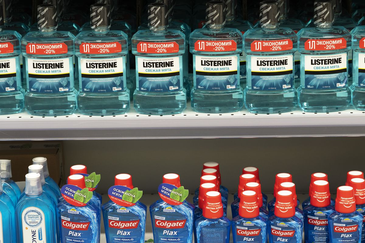 Mouthwashes Listerine and Colgate seen displayed in a...