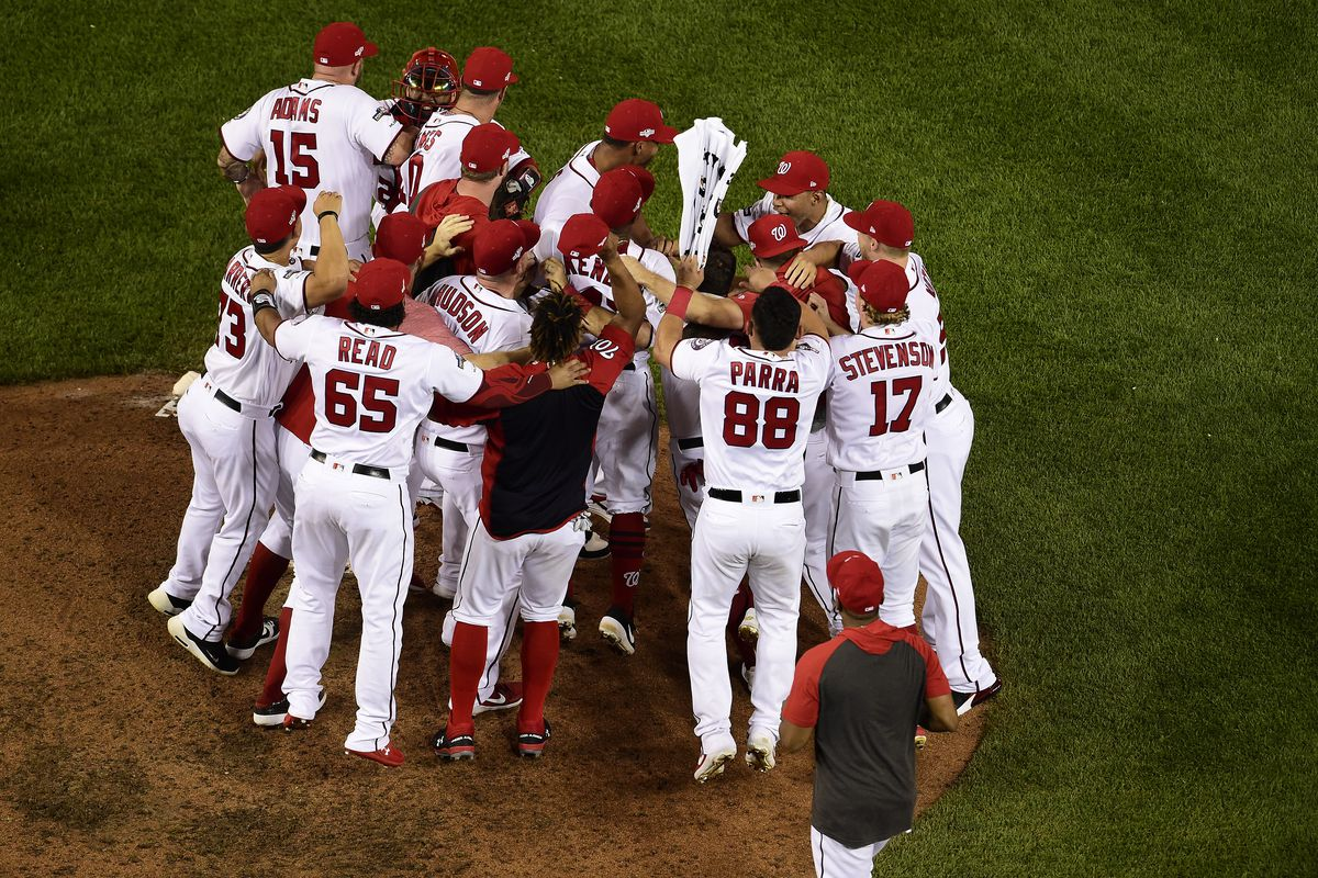 The Washington Nationals celebrate after defeating the Milwaukee Brewers with a score 4 to 3 in the National League Wild Card game at Nationals Park on October 01, 2019 in Washington, DC.