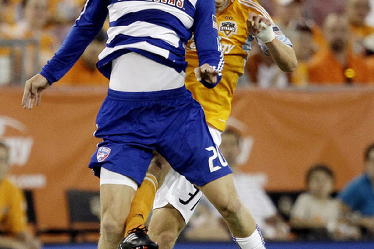 HOUSTON - MAY 05:  Brek Shea #20 of FC Dallas heads the ball away from Andrew Hainault #31 of the Houston Dynamo at Robertson Stadium on May 5, 2010 in Houston, Texas.  (Photo by Bob Levey/Getty Images)