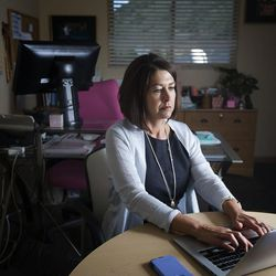 """Park City School District Superintendent Ember Conley gets online to demonstrate how easy it is to buy drugs on the black market during an interview in her office in Park City on Friday, Aug. 11, 2017. It took Conley less than five minutes to find a site that sells the highly dangerous new synthetic opioid known as """"pink"""" or """"pinky."""""""