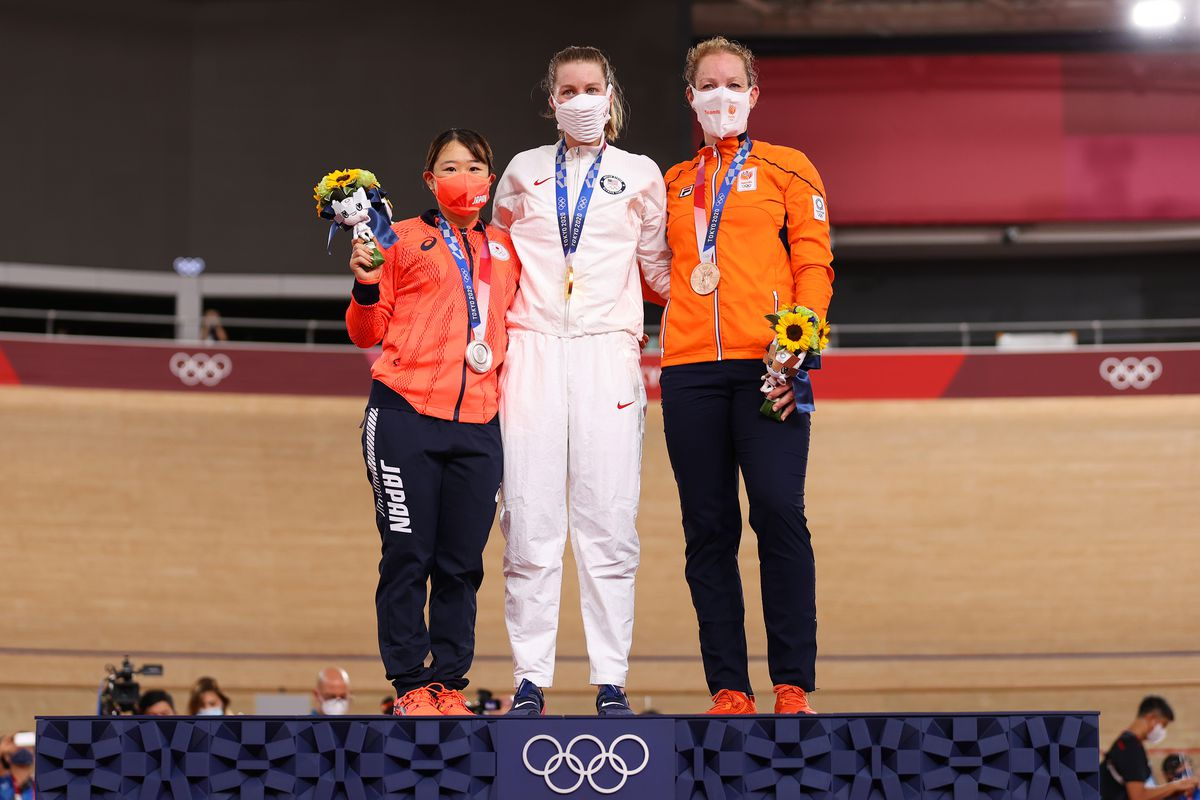 Silver medalist Yumi Kajihara of Team Japan, gold medalist Jennifer Valente of Team United States, and bronze medalist Kirsten Wild of Team Netherlands, pose on the podium during the medal ceremony after the Women's Omnium finals of the track cycling on day sixteen of the Tokyo 2020 Olympic Games at Izu Velodrome on August 08, 2021 in Izu, Shizuoka, Japan.