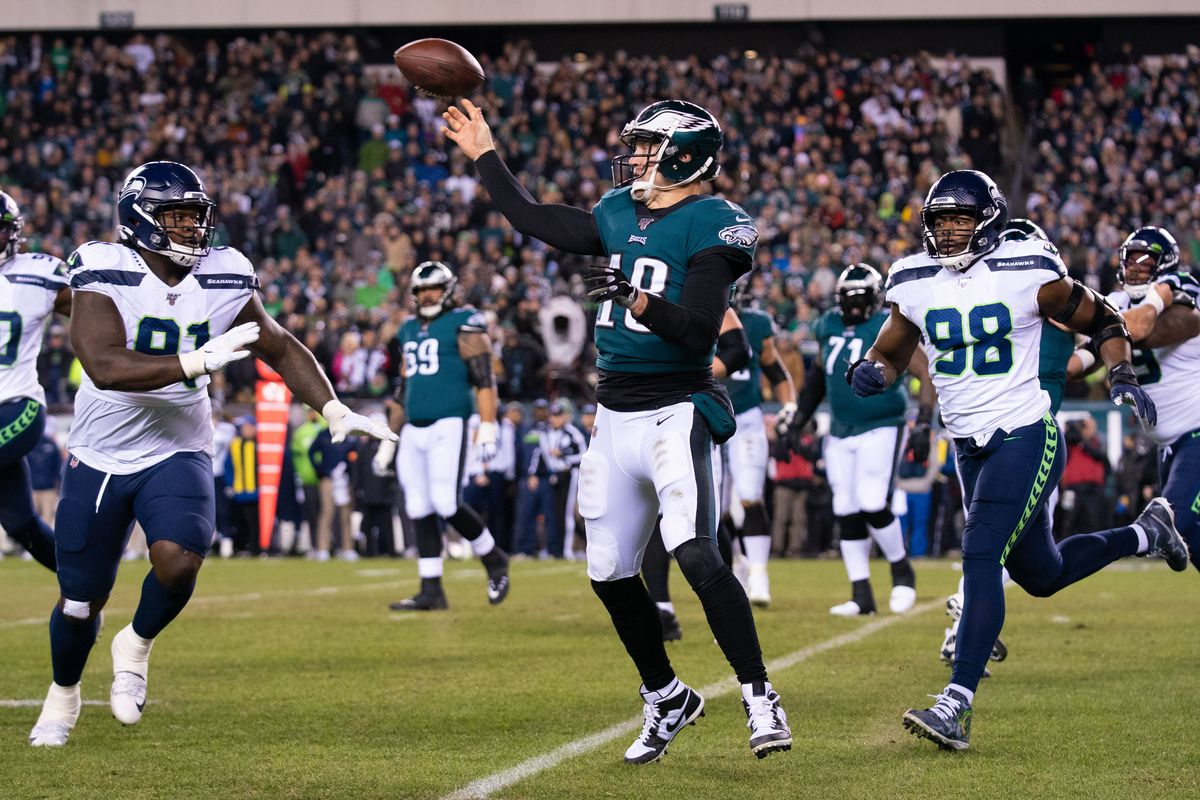 Philadelphia Eagles quarterback Josh McCown passes the ball past the rush of Seattle Seahawks Jarran Reed during the second quarter in a NFC Wild Card playoff football game at Lincoln Financial Field.