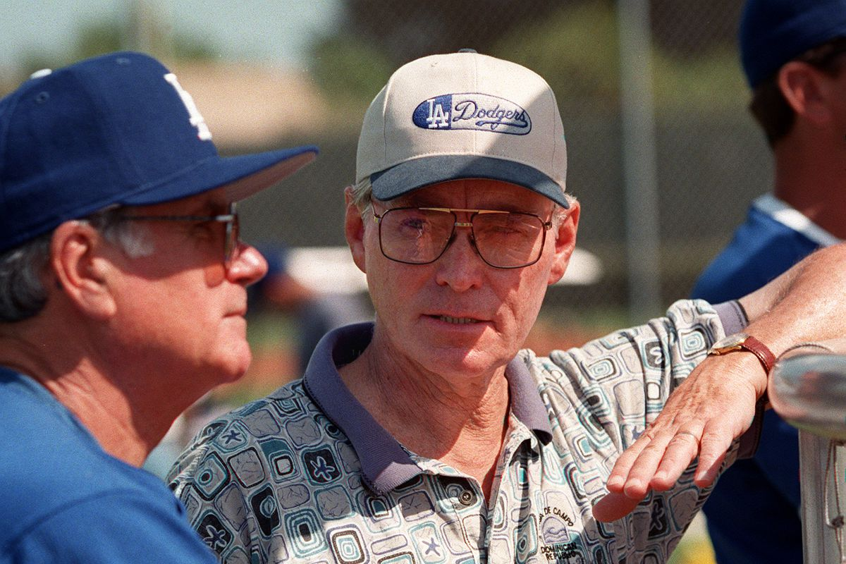 S.Fred Claire.1.0306.KM.f––Fred Claire, Dodgers vice president, talks with coach Joe Amalfitano at s