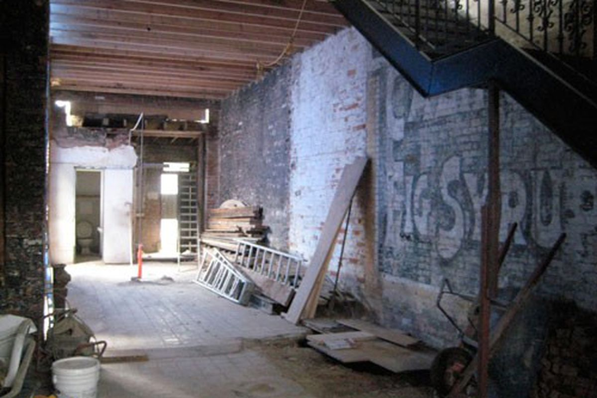 The open kitchen will run along this brick wall, although Patten and Mazza say that sign will no longer be there.