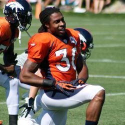 Broncos safety David Bruton does some lunges before the rest of the team comes out before the sixth day of training camp