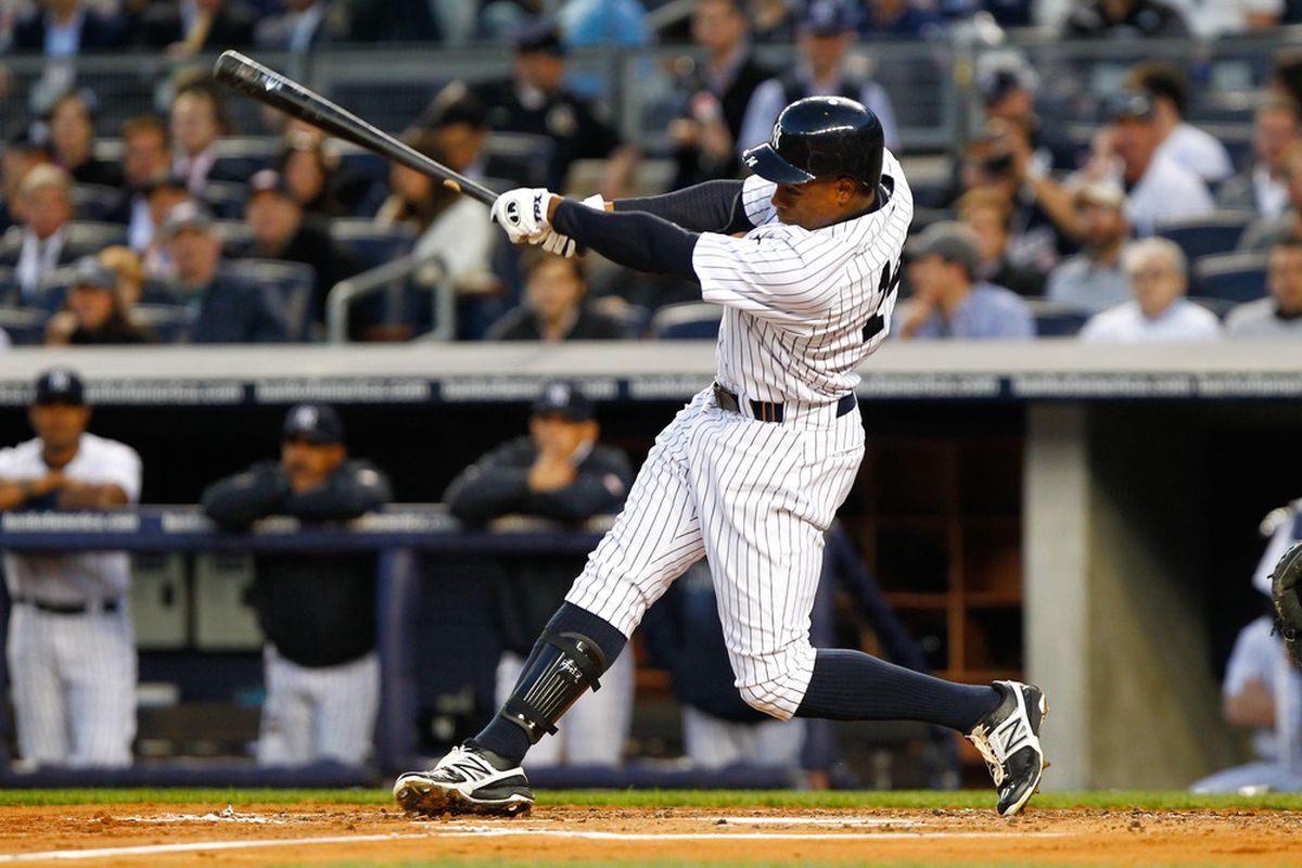Apr. 19, 2012; Bronx, NY, USA; New York Yankees center fielder Curtis Granderson (14) hits a home run to center during the first inning against the Minnesota Twins at Yankee Stadium. Mandatory Credit: Debby Wong-US PRESSWIRE