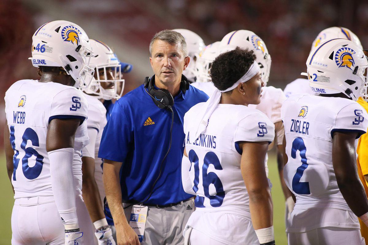 San Jose State head coach Brent Brennan talks to his team during a timeout in the game against Arkansas.