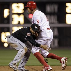 Philadelphia Phillies' Hunter Pence, right, collides with Miami Marlins second baseman Omar Infante on a fielder's choice by Shane Victorino in the second inning of a baseball game on Wednesday, April 11, 2012, in Philadelphia. Pence was ruled out on the play.