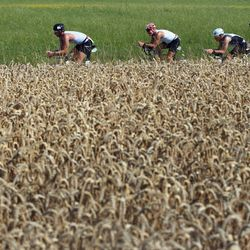 Participants compete on the bike leg during the Challenge Roth on July 20, 2014 in Roth, Germany. (Photo by Alex Grimm/Getty Images)
