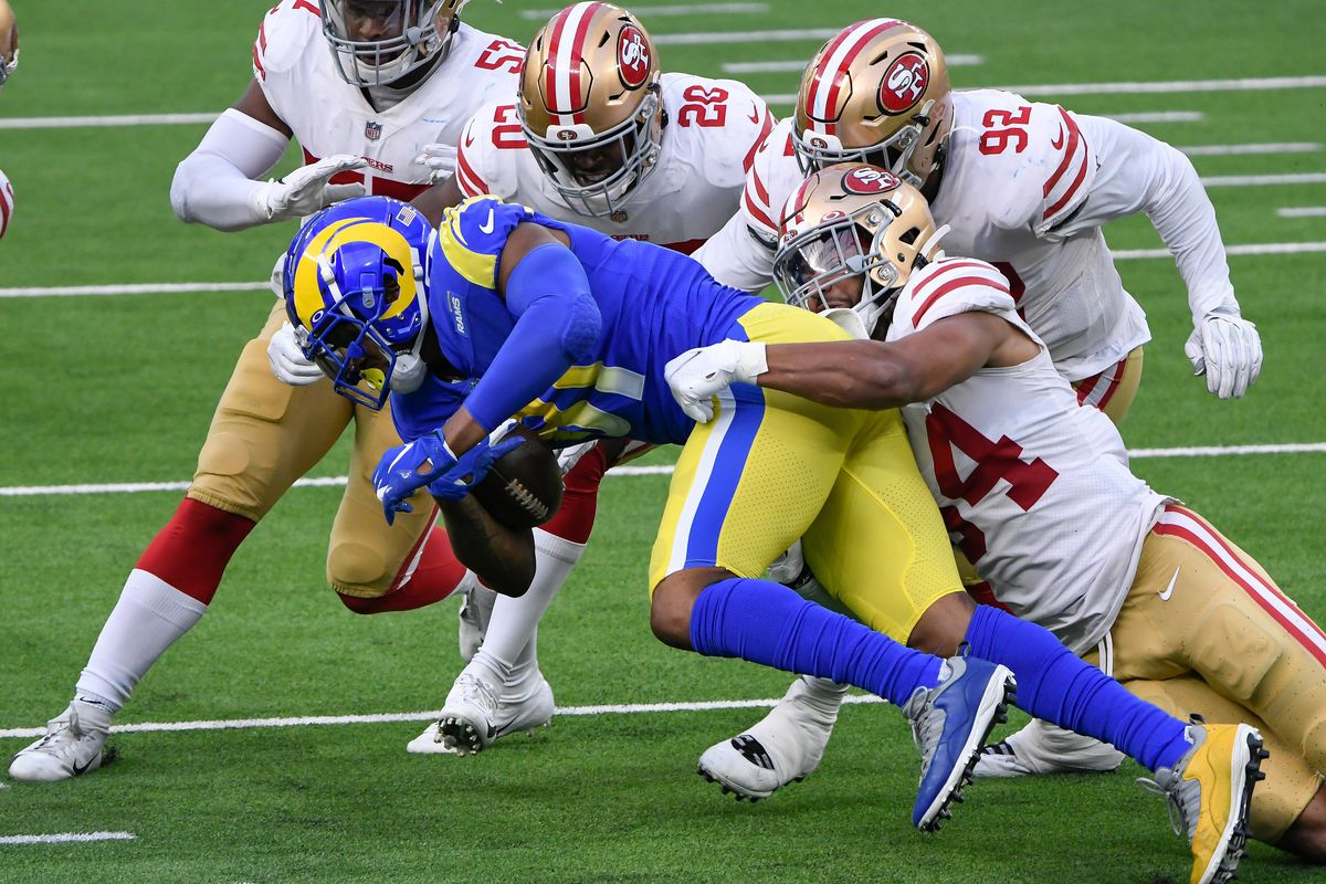 Los Angeles Rams tight end Gerald Everett (81) is gang tackled by San Francisco 49ers outside linebacker Dre Greenlaw (57), free safety Jimmie Ward (20) defensive end Kerry Hyder (92) and middle linebacker Fred Warner (54) during the second quarter at SoFi Stadium.