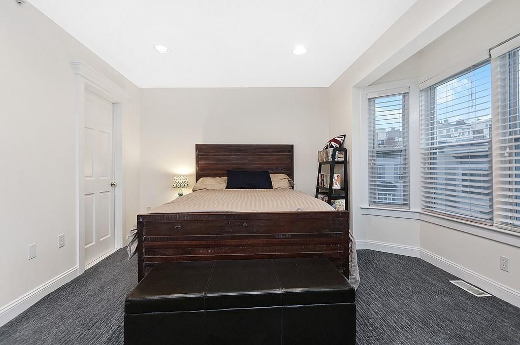 A bedroom with a bed.
