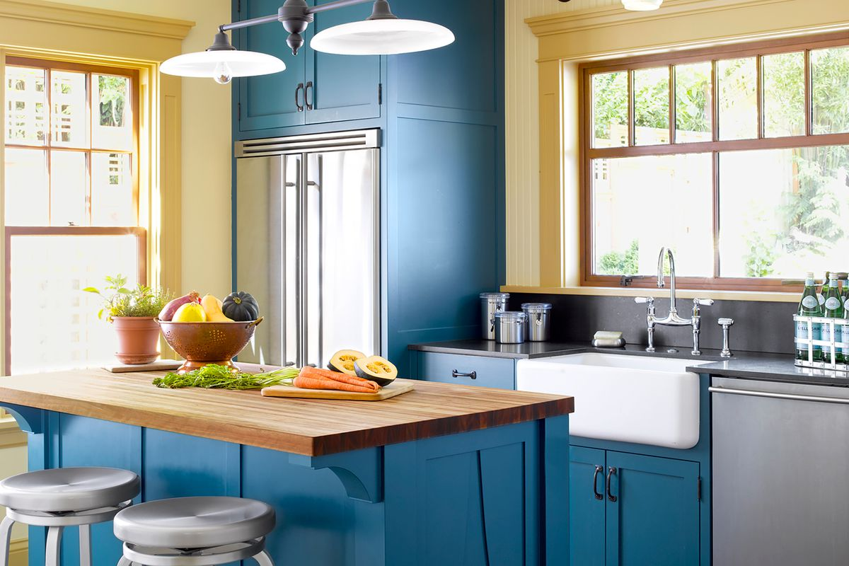 Wood Countertop in a bright blue kitchen.