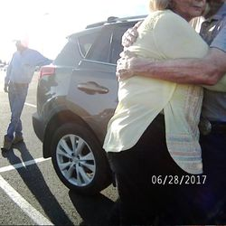 """Karmen Sanone, the self-described """"longtime friend"""" of Gary Ott,  center, hugs the Salt Lake County recorder, right, in body camera footage taken by a Pleasant View police officer in a Harrisville parking lot on Wednesday, June 28, 2017. The footage shows the exchange Ott's family and Sanone had with police the day a judge signed a temporary order granting Ott's family legal guardianship amid concerns about his health."""