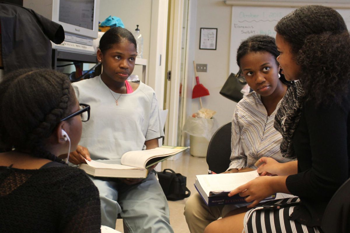 """Madinah Hart, second from right, is taking four AP courses at Renaissance High School this year because """"it allows me to be more advanced when I get to college."""" Most Detroit high school students do not have access to AP classes."""