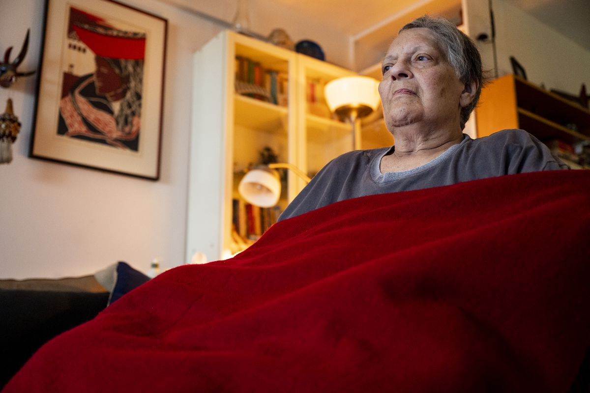 Roberta Singer sits inher Southbridge Towers apartment in Downtown Manhattan after being discharged from VillageCare.