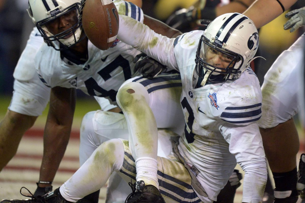Van Noy recovering a fumble for a touchdown against San Diego State in the Poinsettia Bowl.