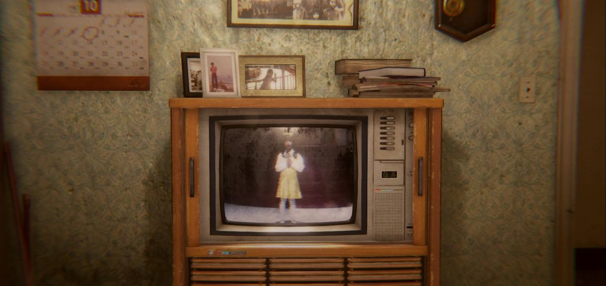 An older TV shows an image of a person singing