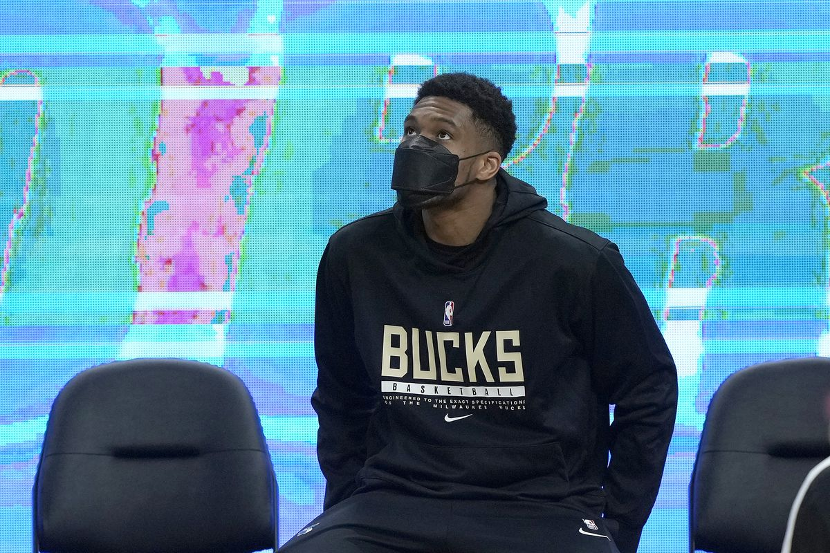 Giannis Antetokounmpo of the Milwaukee Bucks sitting on a gatorade cooler looks on prior to the start of an NBA basketball game against the Golden State Warriors at Chase Center on April 06, 2021 in San Francisco, California.