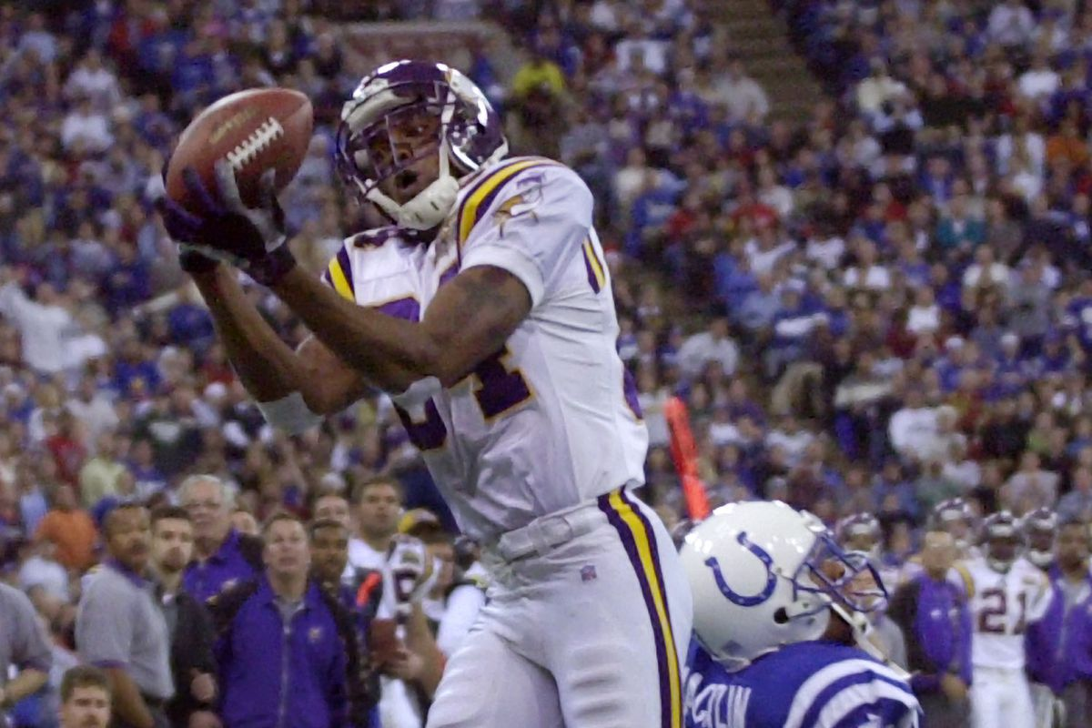 Minnesota Vikings at the Indianapolis Colts Sunday 12/24/00----- Viking Randy Moss pulls down a 42-yard touch down catch in the first quarter against Colts' David Macklin at the RCA Dome in Indianapolis.(Photo By JERRY HOLT/Star Tribune via Getty Images)