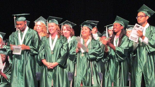 Excel Center graduates cheer their classmates.