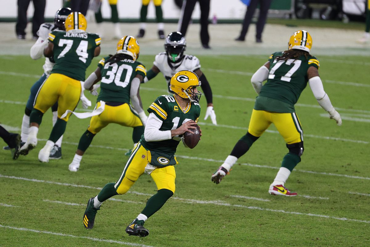 Aaron Rodgers #12 of the Green Bay Packers looks to pass during a game against the Philadelphia Eagles at Lambeau Field on December 06, 2020 in Green Bay, Wisconsin.