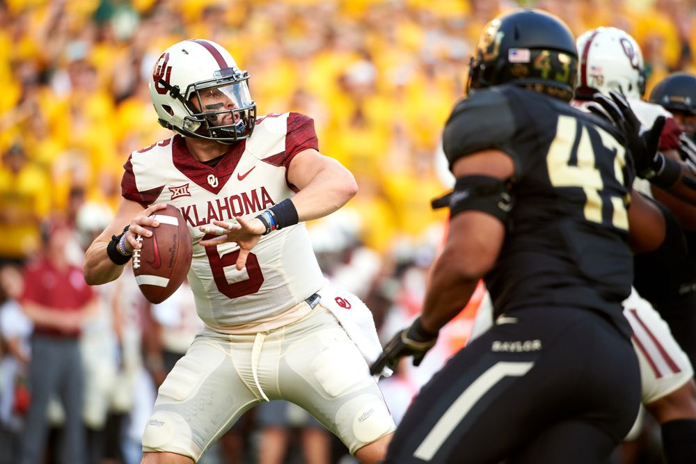 WACO, TX:  Oklahoma Sooners quarterback Baker Mayfield (6) drops back to pass against the Baylor Bears defense at McLane Stadium.
