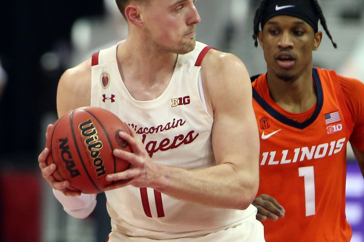 Wisconsin Badgers forward Micah Potter controls the ball against Illinois Fighting Illini guard Trent Frazier during the second half at the Kohl Center.