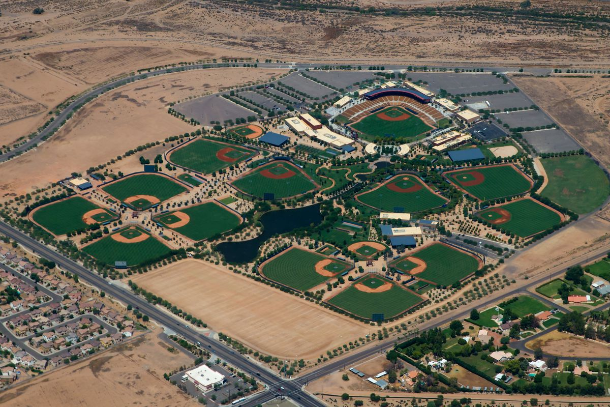 The two Dodgers minor league fields for games are the two fields at the farthest right and bottom of this aerial view of Camelback Ranch (both backing into the dirt parking lot).