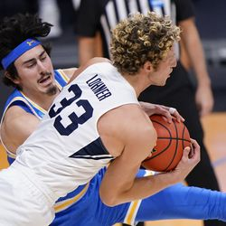 BYU forward Caleb Lohner (33) battles for a rebound with UCLA guard Jaime Jaquez Jr., left, during the first half of a first-round game in the NCAA college basketball tournament at Hinkle Fieldhouse in Indianapolis, Saturday, March 20, 2021.