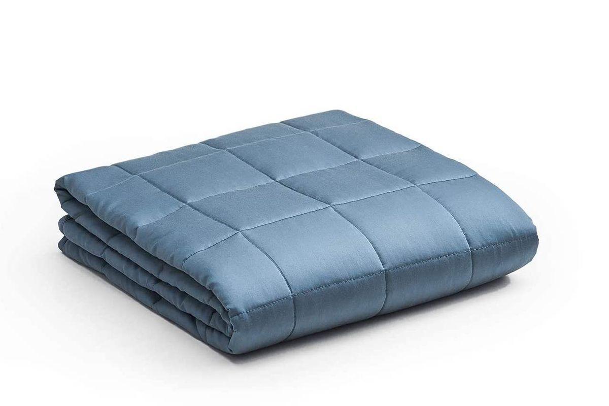 Square, padded light blue blanket.