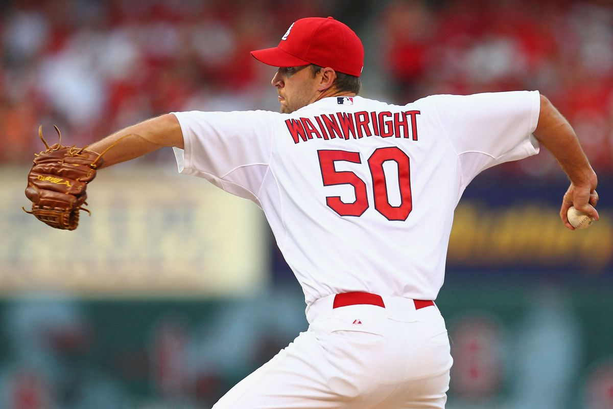 ST. LOUIS, MO - JULY 24:  Starter Adam Wainwright #50 of the St. Louis Cardinals pitches against the Los Angeles Dodgers at Busch Stadium on July 24, 2012 in St. Louis, Missouri.  (Photo by Dilip Vishwanat/Getty Images)