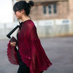 A pleated blouse in a deep shade of burgundy is always an A+ style choice.