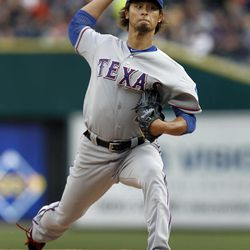 Texas Rangers pitcher Yu Darvish throws against the Detroit Tigers in the first inning of a baseball game in Detroit, Thursday, April 19, 2012.