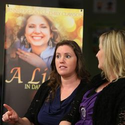 """Jennifer Graves, left, Josh Powell's sister, and co-author Emily Clawson talk about their new book, """"A Light In Dark Places,"""" on Monday, June 24, 2013, in South Jordan. Graves is well-known in Utah and Washington as being an advocate for her missing sister-in-law, Susan Cox Powell, as well as for Susan's sons, Charlie and Braden. In her book, she shares her struggles to have a healthy, normal life despite her tumultuous upbringing."""