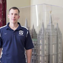 Dave Jungheim stands in front of his Lego model of the Salt Lake Temple.