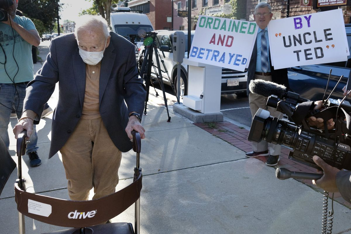Defrocked Cardinal Theodore McCarrick, using a walker, arrives at court Friday in Dedham, Mass., outside Boston. The once-powerful American prelate pleaded not guilty to sexually assaulting a 16-year-old boy during a wedding reception in Massachusetts nearly 50 years ago.