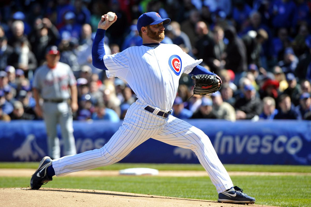 Chicago, IL, USA; Chicago Cubs starting pitcher Ryan Dempster delivers a pitch during the first inning against the Washington Nationals on opening day at Wrigley Field.  Credit: Rob Grabowski-US PRESSWIRE