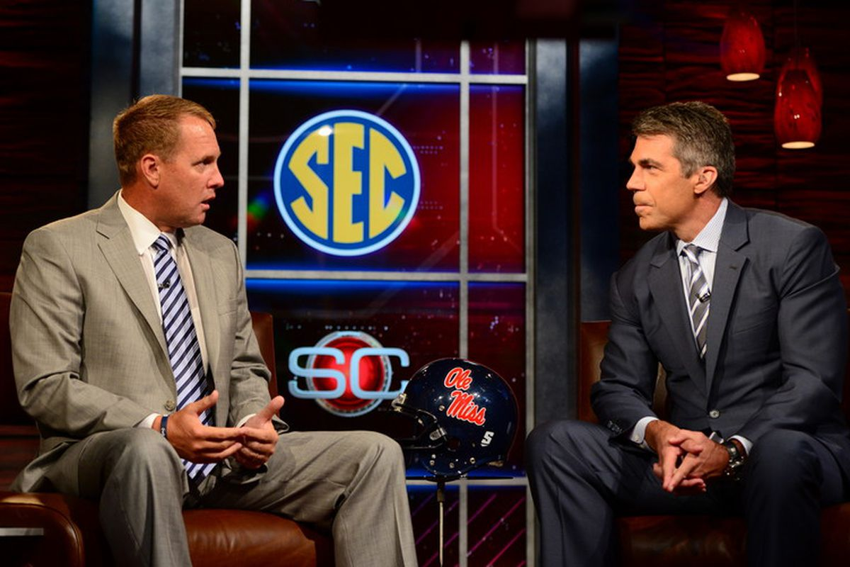 Coach Hugh Freeze speaks with Chris Fowler at ESPN's SEC Coaches Car Wash