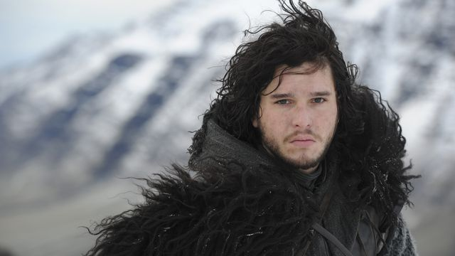 jon snow (kit harington) stares directly into camera in his big wooly black coat