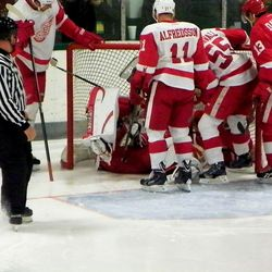 Abdelkader crashed into Jared Coreau and they were both wedged inside the net...
