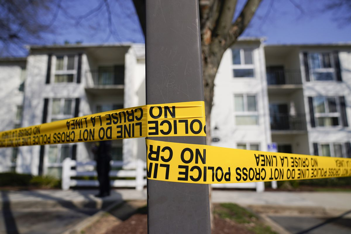 Crime scene tape outside the apartment of Navy Petty Ofc. 3rd Class Fantahun Girma Woldesenbet, assigned to Fort Detrick in Frederick, Md., Tuesday, April 6, 2021.